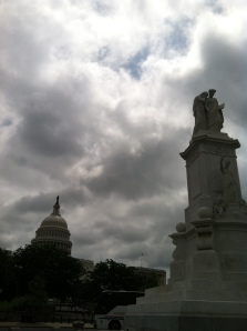 The Peace Monument on the right, the Capitol on the left.  The clouds of war above.