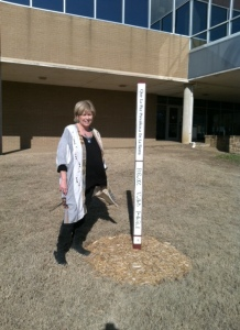 Annie Malloy with TCC's recently planted peace pole
