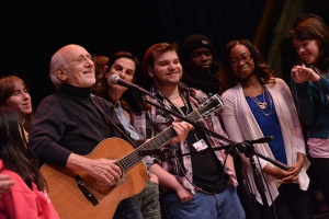 Peter Yarrow at singing on stage with NCC students